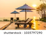 beautiful umbrella and chair... | Shutterstock . vector #1035797290