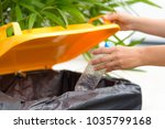 close up hand putting plastic... | Shutterstock . vector #1035799168