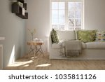 white room with sofa and winter ... | Shutterstock . vector #1035811126
