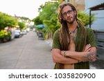 portrait of young handsome... | Shutterstock . vector #1035820900