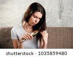 young  beautiful girl is... | Shutterstock . vector #1035859480
