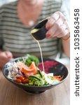 salmon nourish bowl for...   Shutterstock . vector #1035863458