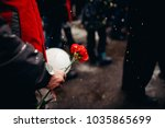adult holds red carnation.... | Shutterstock . vector #1035865699