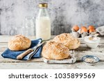 white oatmeal bread buns with... | Shutterstock . vector #1035899569