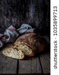 sliced round no knead rustic... | Shutterstock . vector #1035899713