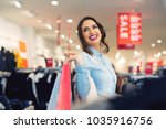 smiling girl with shopping bags ... | Shutterstock . vector #1035916756