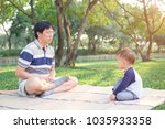 father and cute little asian 18 ... | Shutterstock . vector #1035933358