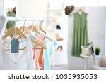 clothes rack in dressing room ... | Shutterstock . vector #1035935053
