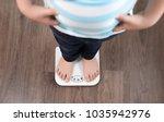 overweight boy standing on... | Shutterstock . vector #1035942976