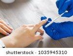 woman hands receiving a... | Shutterstock . vector #1035945310