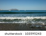 sea surf with far mountains at... | Shutterstock . vector #103595243