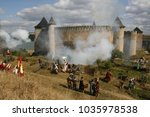 Small photo of The living history festival in Khotyn fortress (Chernivtsi region, Ukraine). Re-enactors stand in cannon smoke trying to conquer the castle. Historical reenactment of medieval battle of Khotyn (1621)