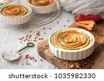 vegetarian  quiche in white... | Shutterstock . vector #1035982330