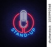 stand up logo in neon style.... | Shutterstock . vector #1035993568