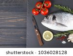 raw fish dorado cooking and... | Shutterstock . vector #1036028128