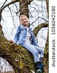 young  blond  beautiful girl is ... | Shutterstock . vector #1036042180
