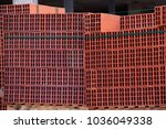 a brick wall in perspective in... | Shutterstock . vector #1036049338