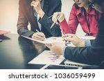 business team meeting at... | Shutterstock . vector #1036059499