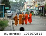 monks in the morning in the old ...   Shutterstock . vector #1036072513