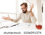 portrait of a confused man... | Shutterstock . vector #1036091374