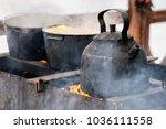 iron cookware at shrovetide ... | Shutterstock . vector #1036111558