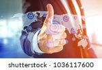 view of a businessman holding a ... | Shutterstock . vector #1036117600