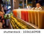 fresh fruit juice for sale at... | Shutterstock . vector #1036160908