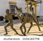 Small photo of Moguer, Spain. Circa February 2018. Sculpture Idilio de Abril by artist Pedro Requejo Novoa stands in the streets of Moguer paying homage to writer Juan Ramon Jimenez and his book Platero y yo.