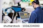 industry 4.0 robot concept ... | Shutterstock . vector #1036234000