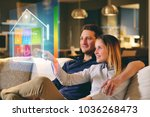 a couple sitting on the sofa... | Shutterstock . vector #1036268473