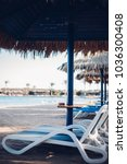 sun loungers and beach... | Shutterstock . vector #1036300408