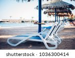 sun loungers and beach... | Shutterstock . vector #1036300414