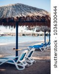 sun loungers and beach... | Shutterstock . vector #1036300444