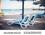 sun loungers and beach... | Shutterstock . vector #1036300450