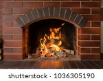 A Brick Fireplace In Which A...