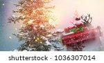 santa flying his sleigh against ... | Shutterstock . vector #1036307014