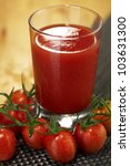 fresh tomato juice garnished... | Shutterstock . vector #103631300