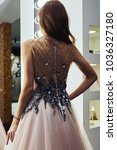 girl is buying a dress in the... | Shutterstock . vector #1036327180