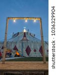 view of circus tent framed in a ... | Shutterstock . vector #1036329904