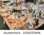 on wooden table in wedding... | Shutterstock . vector #1036353646