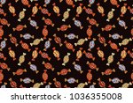 candies on black  orange and... | Shutterstock . vector #1036355008