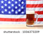 glass of beer on table against... | Shutterstock . vector #1036373209