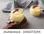 glass jar with vanilla pudding... | Shutterstock . vector #1036373254