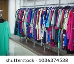 fashion clothes hanging closeup | Shutterstock . vector #1036374538