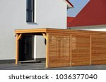 high quality wooden carport  | Shutterstock . vector #1036377040