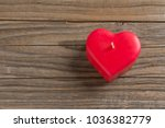 red heart shaped candle on a... | Shutterstock . vector #1036382779