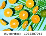 fresh oranges on blue... | Shutterstock . vector #1036387066
