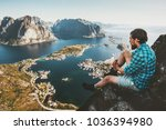 traveler man sitting on cliff... | Shutterstock . vector #1036394980
