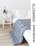 bed with white linen and grey... | Shutterstock . vector #1036402774
