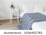 bed with white linen and grey... | Shutterstock . vector #1036402783